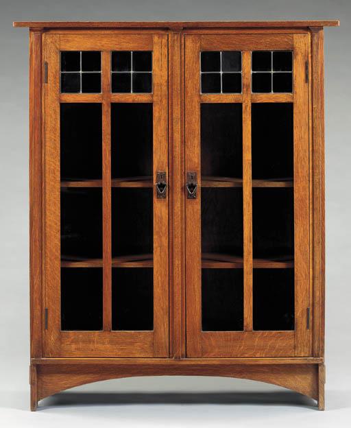 AN OAK TWO-DOOR BOOKCASE , HARVEY ELLIS FOR GUSTAV