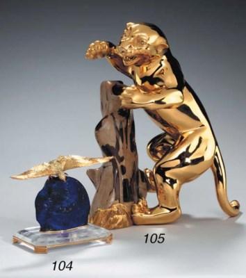 A GOLD, LAPIS LAZULI AND ROCK