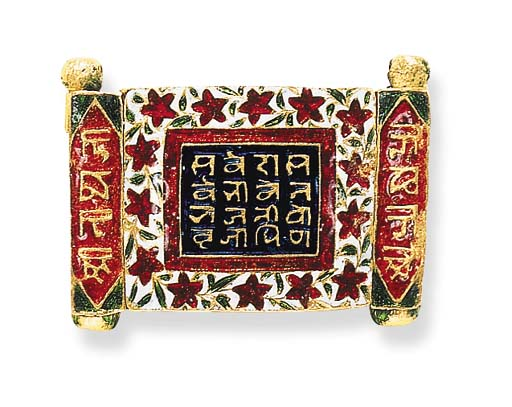 AN INDIAN ENAMEL AND GOLD CLAS