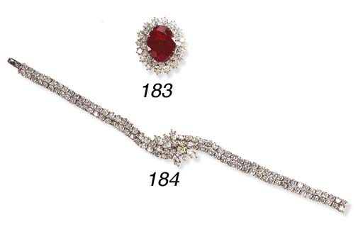 A DIAMOND BRACELET, BY HARRY W