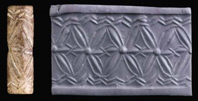 A SUMERIAN BROWN STONE CYLINDE