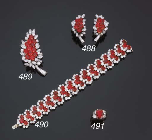 Spilla in rubini e diamanti, f
