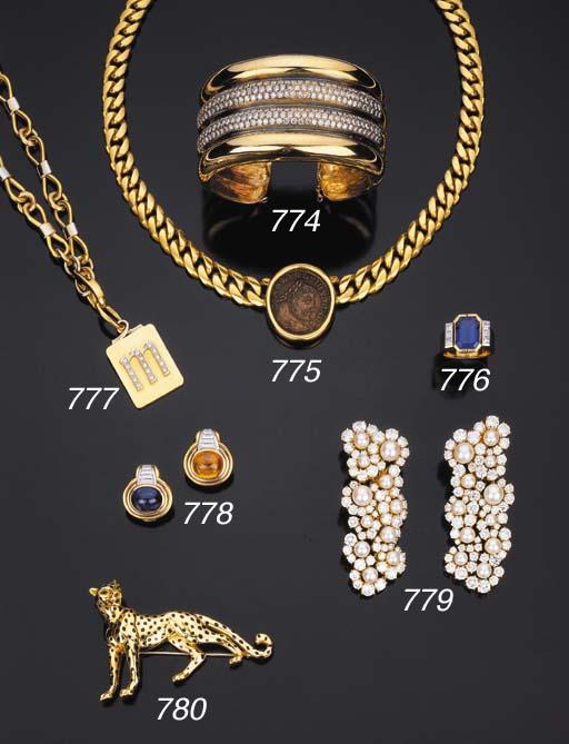 Spilla in oro, firmata Cartier