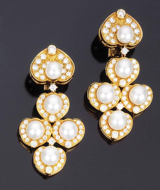 Paio di orecchini con perle coltivate e brillanti