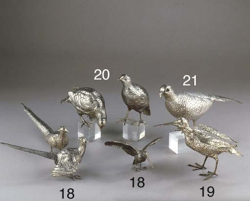 A pair of silver partridges