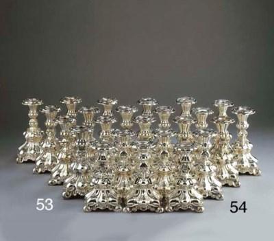 Twelve silver-plated candlesti