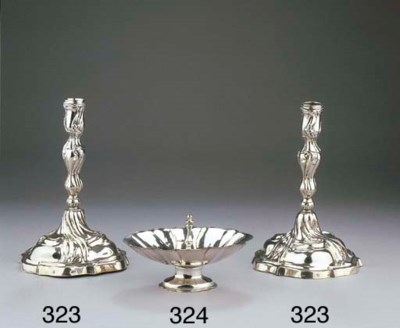 A of pair silver candlesticks
