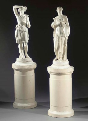 Two white painted plaster figu
