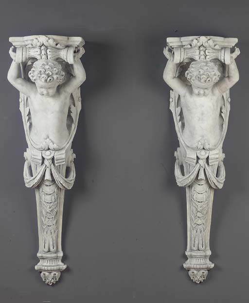 A pair of plaster consoles