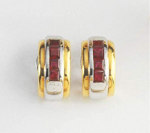 A PAIR OF RUBY AND GOLD EARCLI