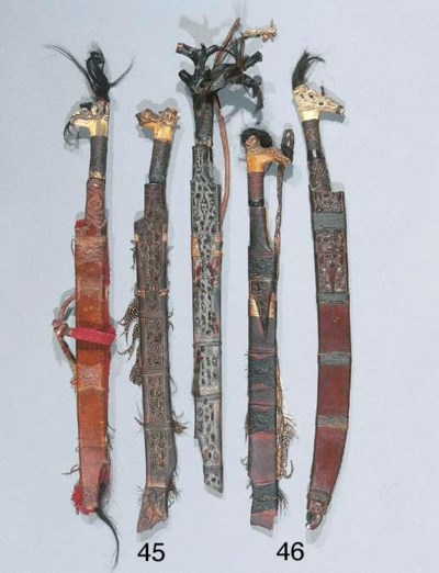 TWO DAYAK SWORDS AND SHEATHS