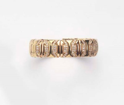A GOLD AND DIAMOND BANGLE