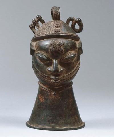 A FINE YORUBA BRASS BELL-HEAD