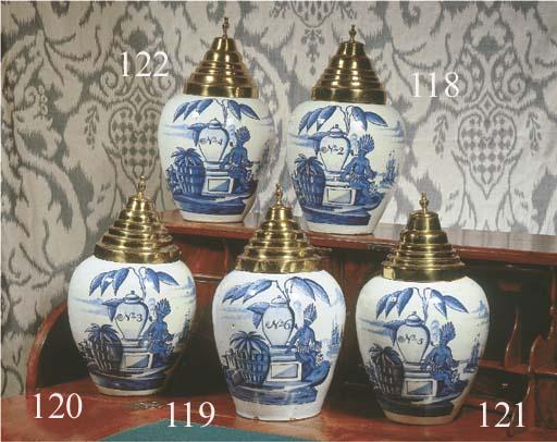 A Dutch Delft blue and white V.O.C. tobacco jar and copper cover