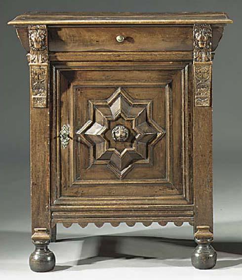 A Flemish oak and walnut dwarf cabinet