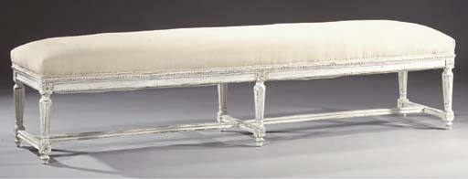 A white-painted settee