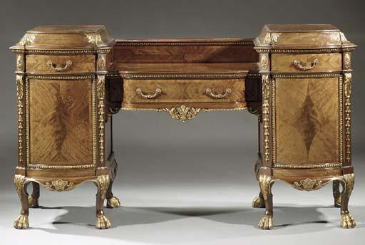 An English parcel-gilt and mahogany sideboard