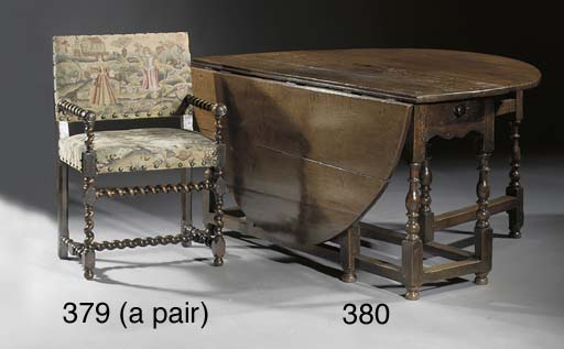 A pair of stained oak fauteuil