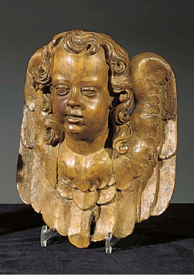 A carved wood mask of a winged