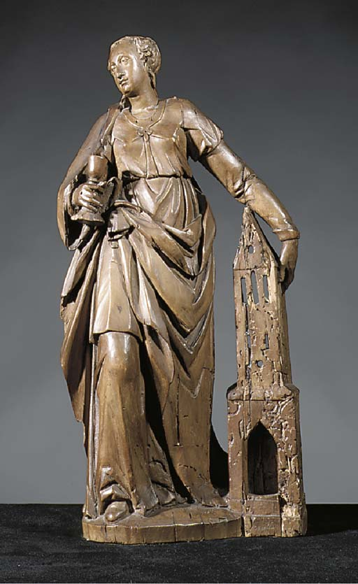 A carved wood figure of St. Ba