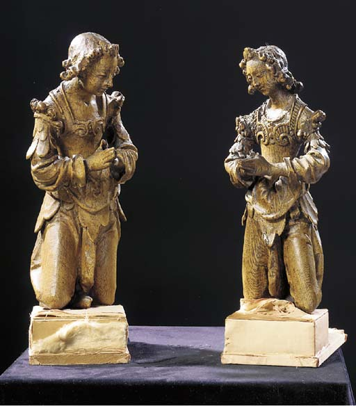 A matched pair of oak kneeling
