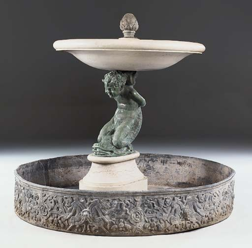 A marble and bronze fountain w
