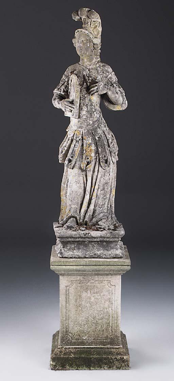 A carved limestone figure of a