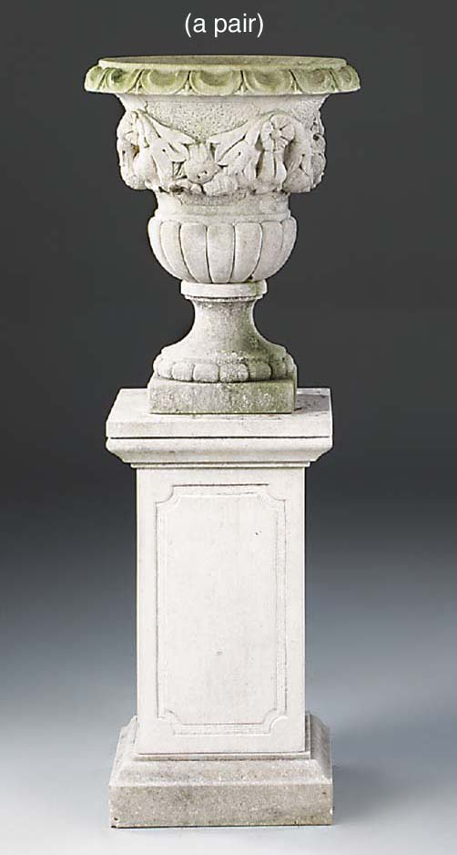 A pair of carved limestone urn