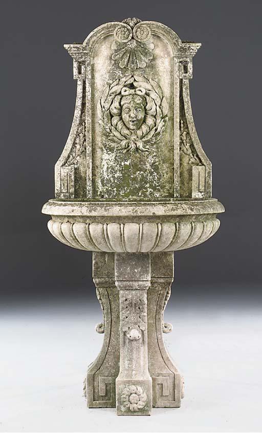 A carved limestone wall founta