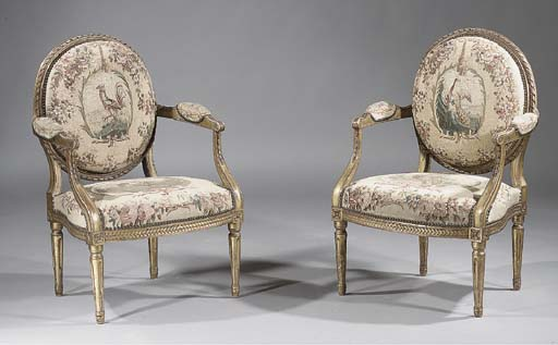 A pair of Louis XVI carved gil