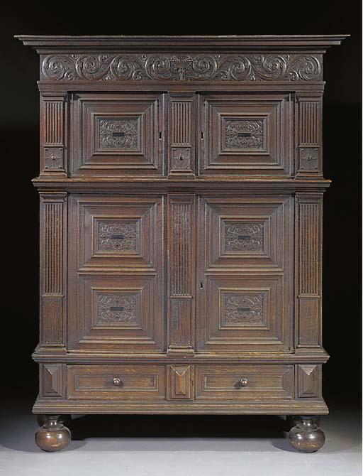 A Dutch stained oak cupboard