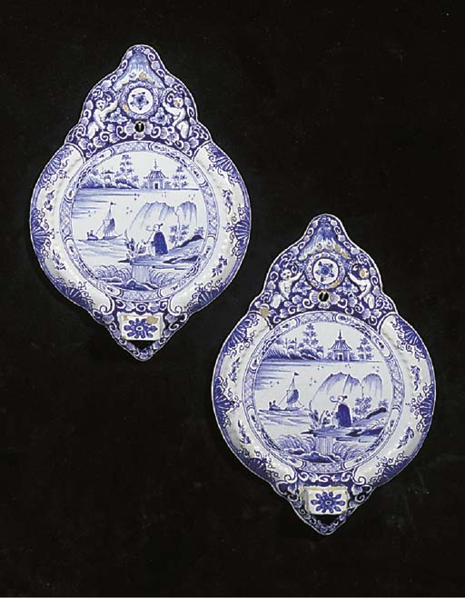 A pair of Dutch Delft blue and white chinoiserie wall sconces