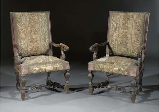 A pair of Louis XIV walnut fau