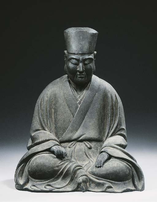 A black lacquer figure of a pr