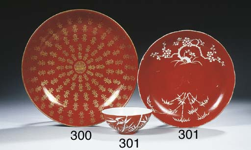 A coral-glazed bowl and a sauc