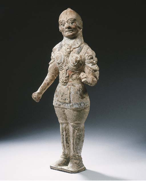 A red pottery figure of a loka