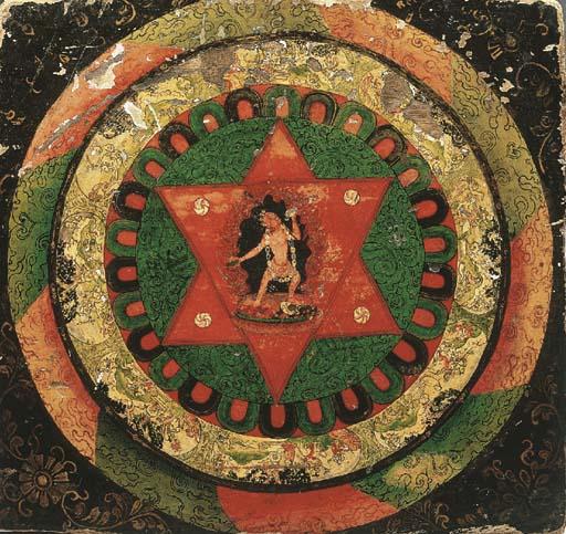 a tibetan polychromed wooden m