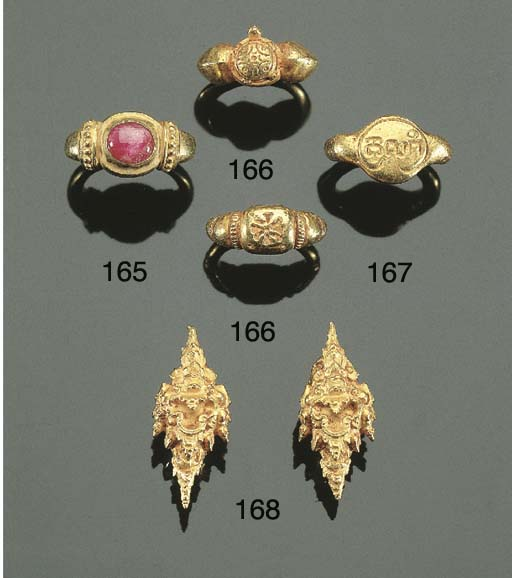 a pair of javanese gold ear ri