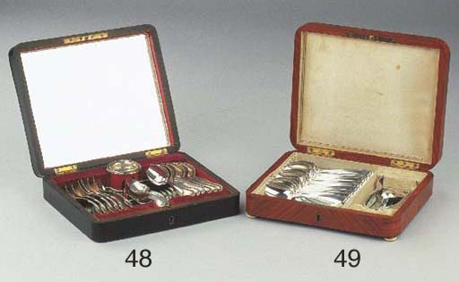 A wooden case with Dutch silve