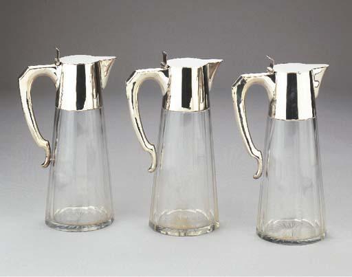 Three silver-mounted cut-glass