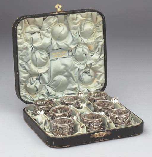 A case with eight Dutch silver
