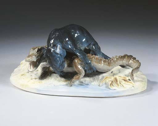 A Meissen oval group of a lion
