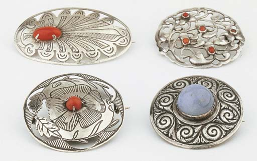 Two silver brooches