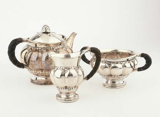 A Danish hammered silver tea s