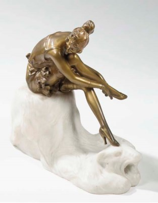 A patinated bronze and marble