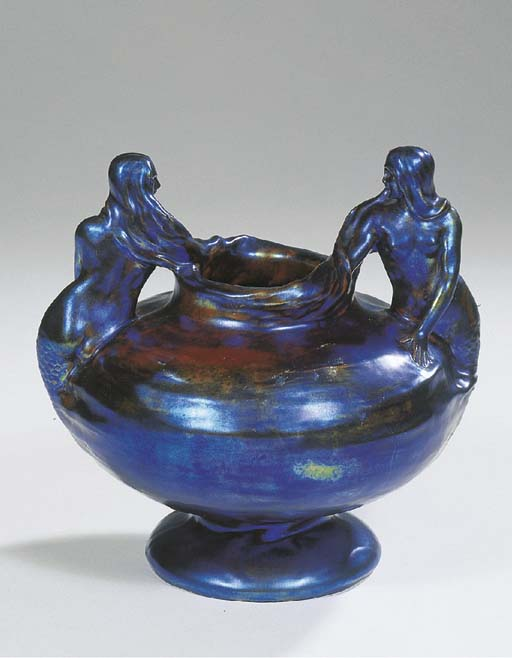An iridescent glazed vase