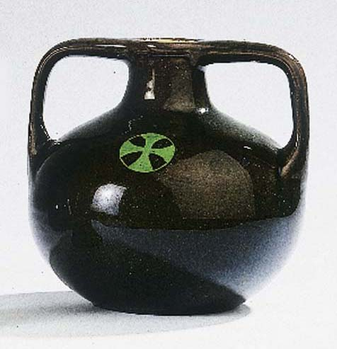 An olive green glazed vase