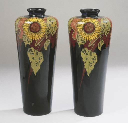 A pair of glazed pottery vases