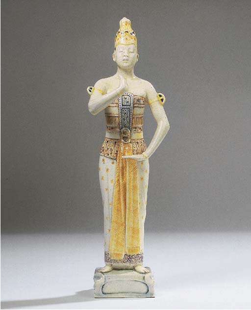 A glazed pottery figure of a J