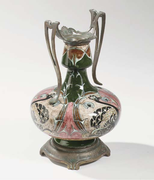 A bronze mounted glazed potter